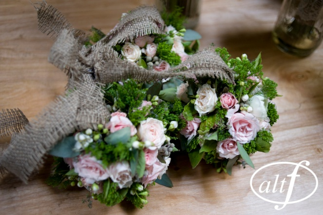 Blush and green flower girl pomanders with burlap ties by Layers of Lovely Floral Design