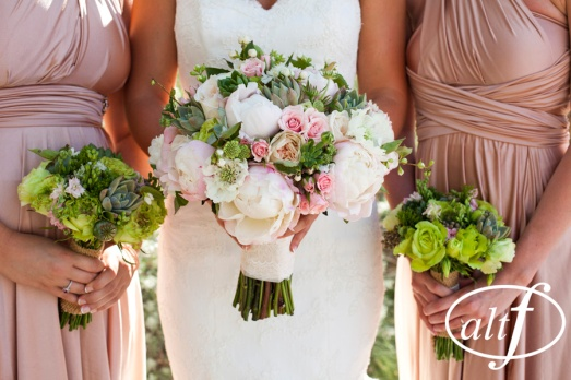 Blush and ivory bridal bouquet with green bridesmaids bouquets by Layers of Lovely Floral Design