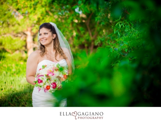 Large bridal bouquet of white florals with pops of green, hot pink and orange by Layers of Lovely Floral Design