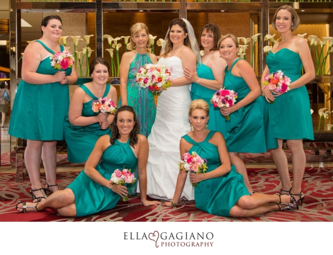 Bridal party in teal with bouquets of white, hot pink and orange by Layers of Lovely Floral Design