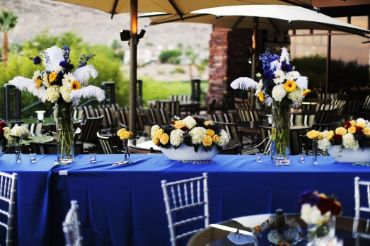 Primary colored floral arrangements by Layers of Lovely Floral Design at Red Rock Country Club