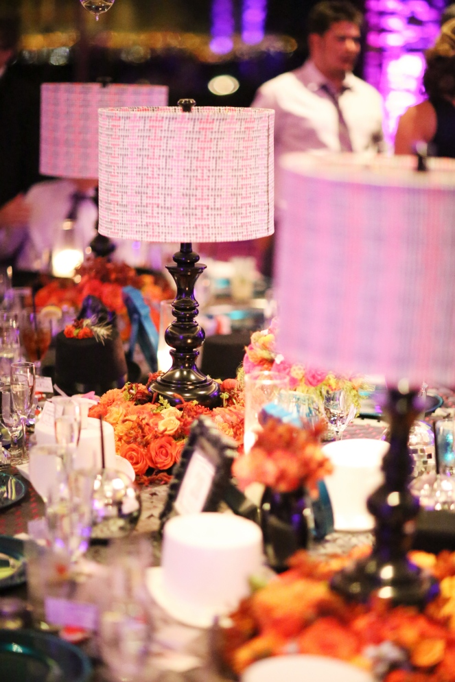 Long table lined with lamp centerpieces by Layers of Lovely Floral Design