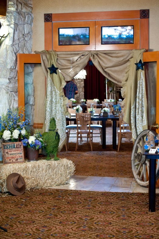 Cowboy baby shower entrance with hay bails and burlap by Layers of Lovely Floral Design