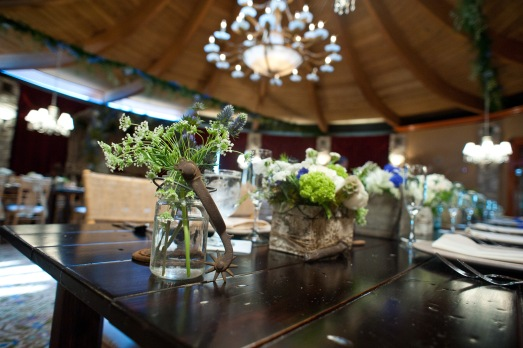 Rustic vases with accents of western themed decor by Layers of Lovely Floral Design