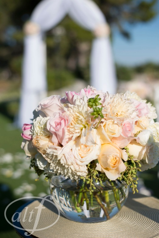 Aisle arrangement of blush and ivory by Layers of Lovely Floral Design