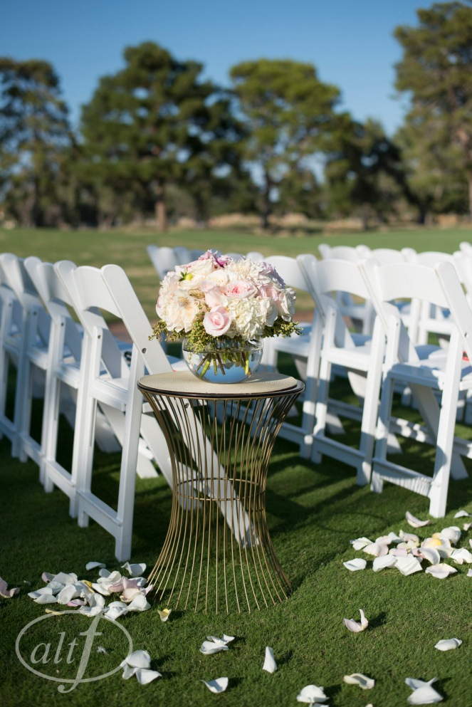 Ceremony florals on gold tables in the aisle by Layers of Lovely Florals Design