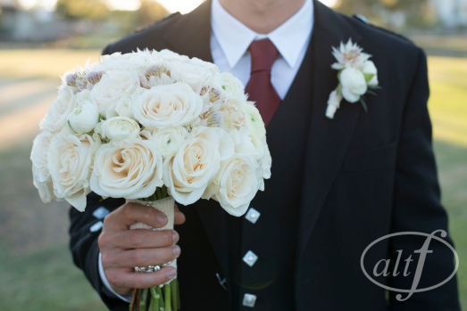 Blush and ivory bridal bouquet of roses, ranunculus, and blushing bride by layers of lovely florals design