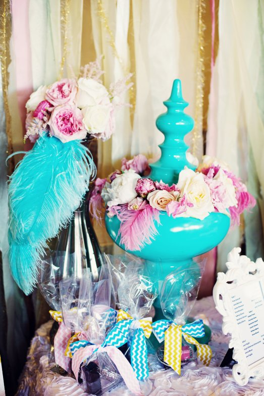 Pink and ivory florals with teal feathers and vases by Layers of Lovely Floral Design