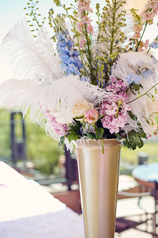 Tall floral arrangements with ostrich feather accents by Layers of Lovely Floral Design