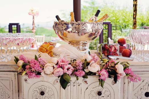 Blush florals with feather accents in buffet drawer by Layers of Lovely Floral Design