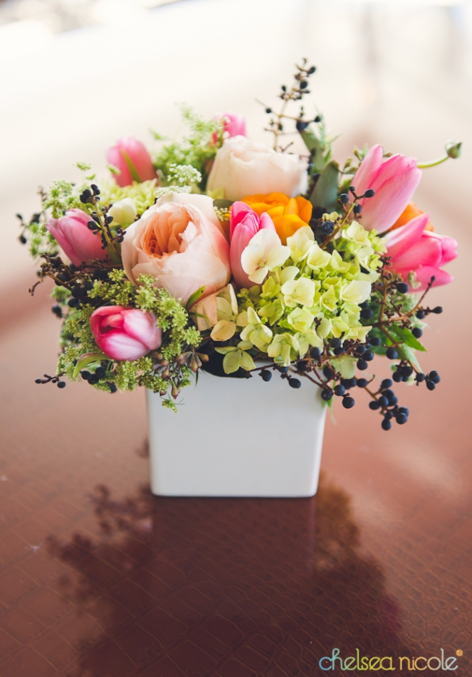 Floral arrangement of peach, coral and green by Layers of Lovely