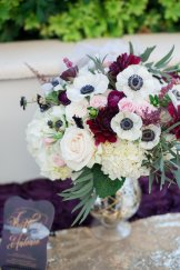 Hydrangea, anemones, dahlias and roses in a mercury vase.