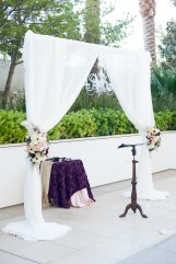 Floral arrangements on white draping