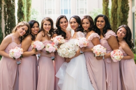 Ivory bridal bouquet with pink accents in bridesmaids bouquets.