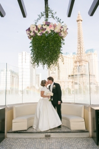 An elegant wedding on the Las Vegas Strip at the Bellagio. Florals by Layers of Lovely, design by Scheme Events, Photography by Meg Ruth