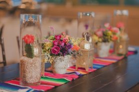Colorful fiesta inspired wedding at the Springs Preserve. Designed by Scheme Events, Florals by Layers of Lovely, Photography by Adam Trujillo