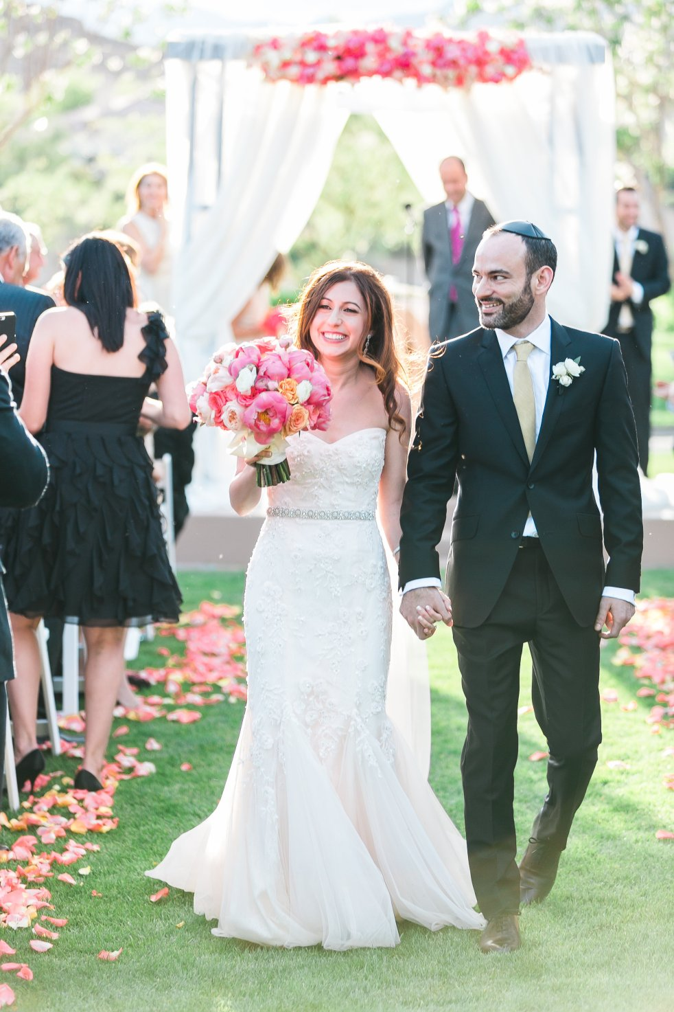 Coral and peach wedding at Red Rock Country Club. Florals by Layers of Lovely. Photography by J. Anne Photography.
