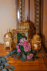 Moroccan gold lanterns with spilling florals.