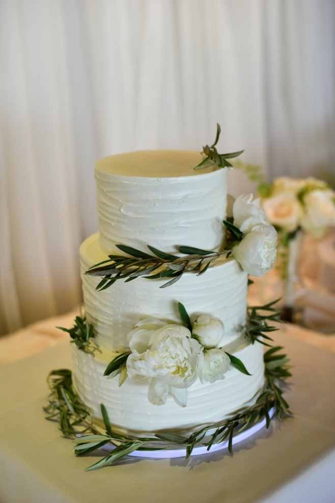 Cake with olive branch and peonies