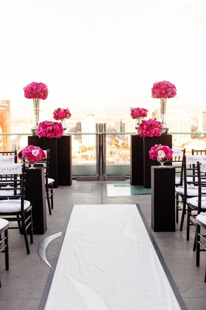 Ghost Bar at Palms Casino wedding designed by Scheme Events, Florals by Layers of Lovely, Photography by Norina Kaye, Ceremony by Peachy Keen Unions by Angie Kelly. Pink Vegas Wedding.